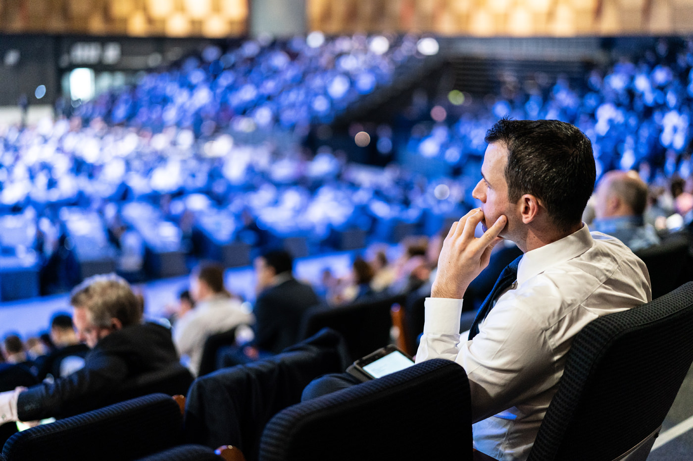 A delegate listens at the CFA Annual Conference at the ICC Auditorium ExCel London