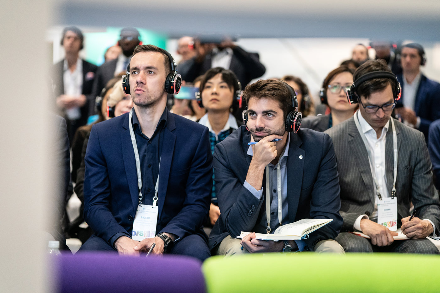 Delegates wearing headphones for Investment Forum at the CFA Conference in the Capital Hall at ExCel London